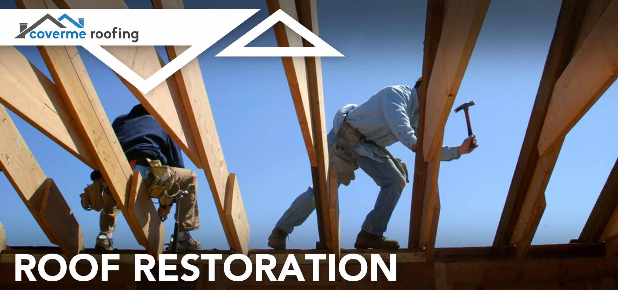 two workers repairing roof